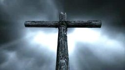 stock-footage-loop-features-an-old-rugged-wooden-cross-standing-against-a-time-lapse-motion-cloud-sky-with-rays